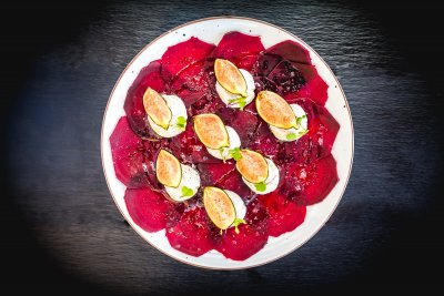 Roasted beetroot carpaccio with labneh cream cheese and local Ibizencan figs